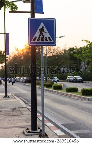 The traffic signs crosswalk in the evening - stock photo