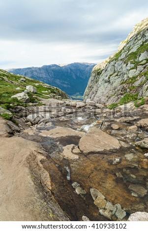 The trail to Kjeragbolten Kjerag mountain, Lysefjord. Norway - stock photo
