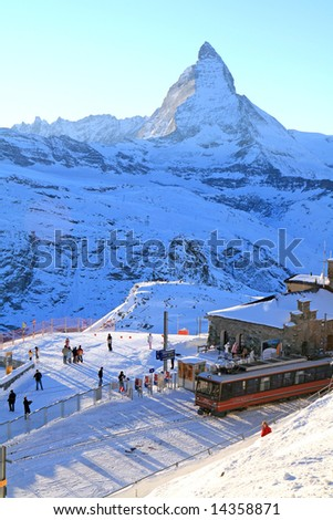 The train station in Gornergrat, at the Swiss Alps with the Matterhorn in the background as the sun begins to set. - stock photo