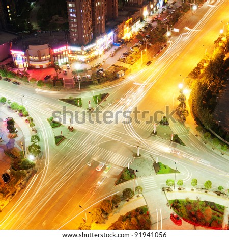 The trajectory of the road intersection at night - stock photo