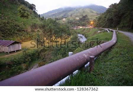 The Trans-Andean oil pipeline on the western slope of the Andes, Ecuador. This pipeline links oilfields in the Amazon with a refinery on the Pacific coast. - stock photo