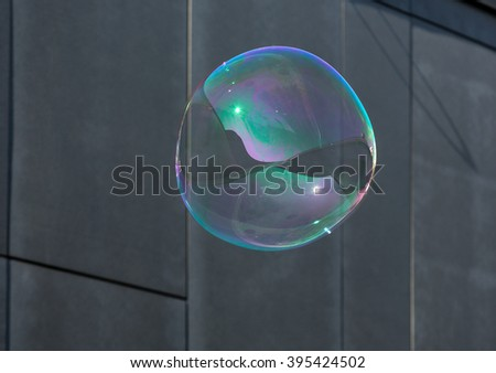The transparent, iridescent soap bubbles  on black background - stock photo