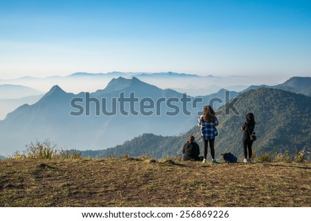 The traveling women and high mountains - stock photo