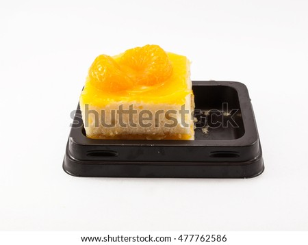 The tray of orange cake on white background.