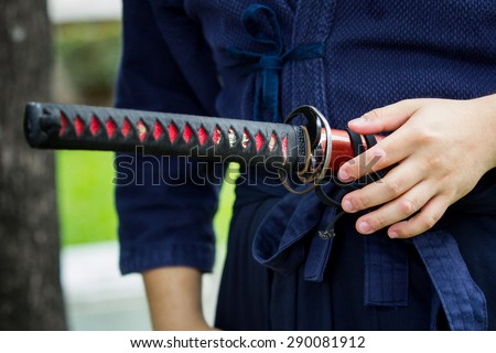 The treaditional Japanese sword (Katana sword) holding in Samurai hand prepare to flighting. - stock photo