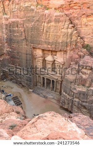 The Treasury in the  Ancient city of Petra carved out of the rock, Jordan as seen from the cliff. - stock photo