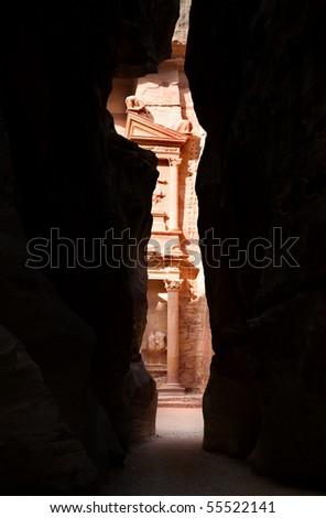 The Treasury viewed from a narrow in the Siq, Petra, Jordan - stock photo