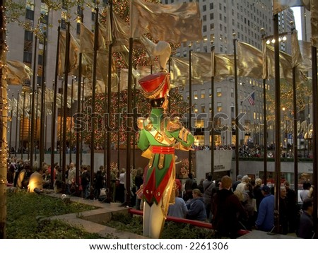 The tree, a wooden soldier decoration, golden flags and colorful lights attracts thousands of people to Rockefeller Center during the holidays.