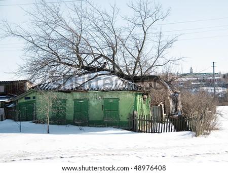 The tree has fallen the house - stock photo