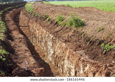 The trench for laying water pipes in the field in Alentejo from Alqueva, Portugal