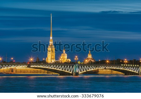 The Trinity (Troitsky) Bridge and Cathedral of Saints Peter and Paul. The White Nights in St.-Petersburg, Russia - stock photo