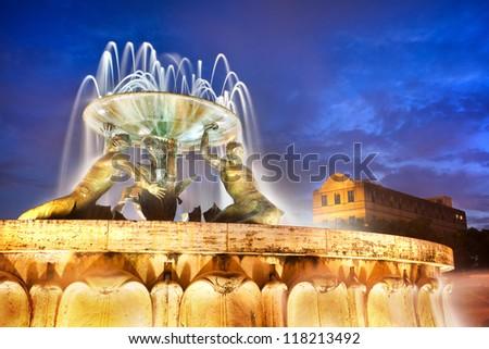 The Triton Fountain at the entrance of Valletta, Malta - stock photo