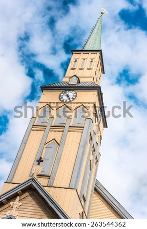 The Tromso Cathedral (Tromso domkirke) is the only Norwegian cathedral made of wood, built in 1861 in Norway. - stock photo