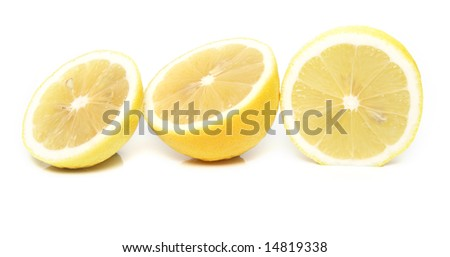 The tropical fruit known as lemon, cut across. The image is isolated on white. Shallow DOF. Close-up.