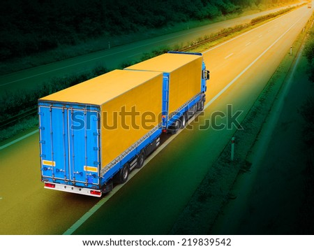 The truck on the highway. - stock photo