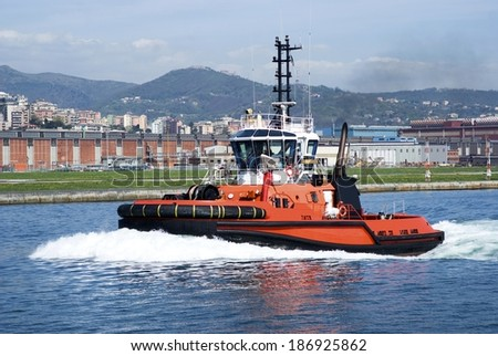 The tugboat in Genoa Harbour, Italy - stock photo