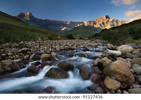 The Tugela River flows gently down from the slopes of the Ampithetare in the Royal Natal National Park in the Drakensberg Mountains - stock photo