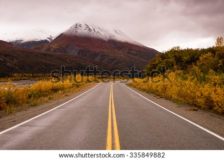 The tundra reacts to the weather in remote Alaska near the highway - stock photo
