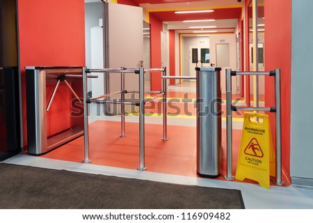 The turnstile in a modern office building - stock photo