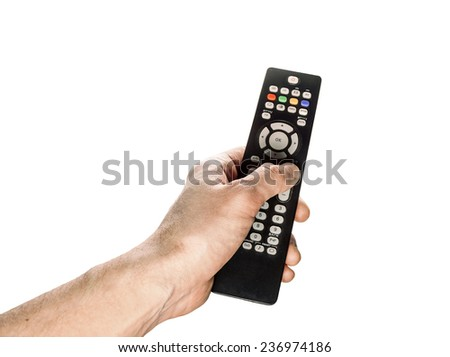 The TV remote control in male hand isolated on white background
