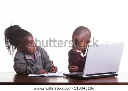 The two children help each other. - stock photo