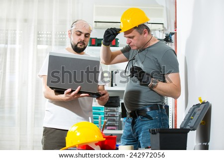 The two craftsmen working together, selective focus - stock photo