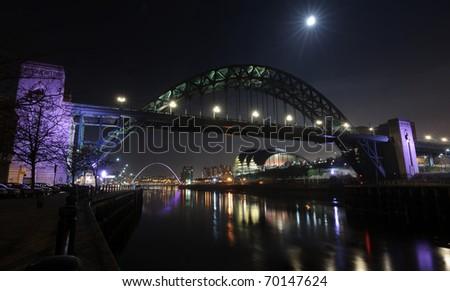 The Tyne Bridge at Newcastle/Gateshead under a full moon. - stock photo