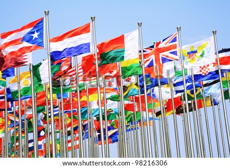 The uk France switzerland and national flags is flying around the world - stock photo