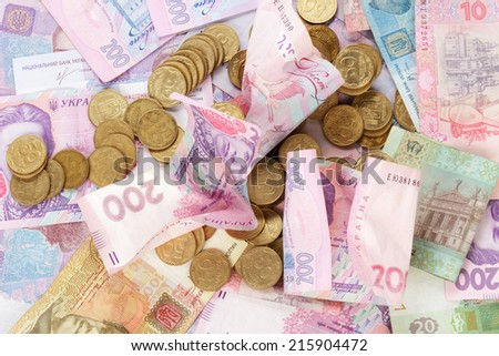 The Ukrainian coins on banknotes as background - stock photo