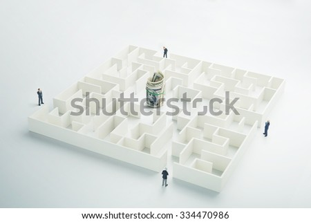 The uncertainty of money and business. Dollar banknotes hidden inside a maze - stock photo