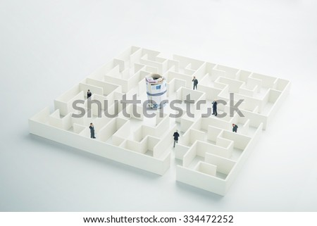 The uncertainty of money and business. Euro banknotes hidden inside a maze - stock photo