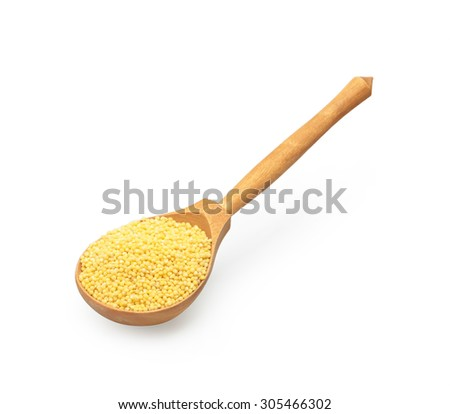 the uncooked white millet in wooden spoon - stock photo