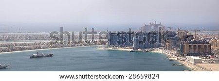 The under construction Palm Jumeirah, The picture shows the bottom left side of Palm and the Atlantis Hotel. - stock photo
