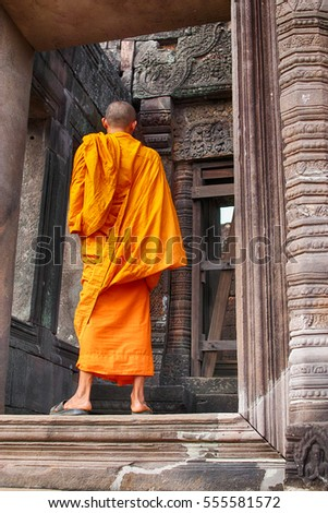 The UNESCO World Heritage temple site Wat Phu in Southern Laos. A monk who cannot be identified is seen walking through the main doorway.