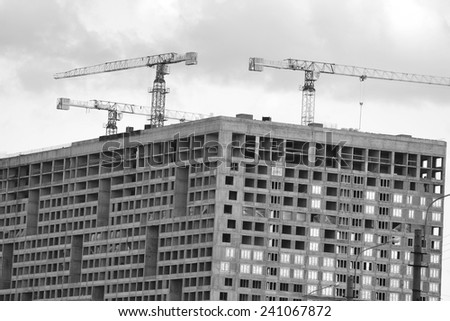 The unfinished building. Black and white. - stock photo