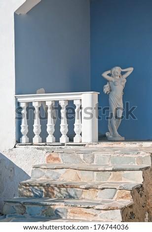 The unidentified veranda decorated with statue in Fira, Santorini, Greece - stock photo