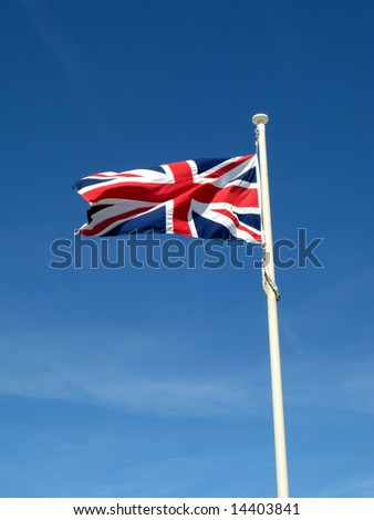 The Union Flag of Great Britain blowing in the wind.