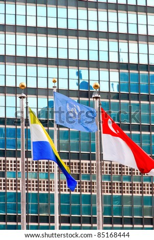 The United Nations building in New York City, home of the UN security council, and flag pole - stock photo