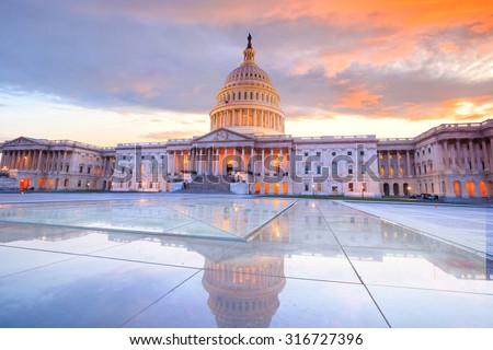 The United States Capitol building with the dome lit up at night USA.  - stock photo