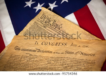 the United States Constitution and Declaration of Independence on a Betsy Ross Flag background - stock photo