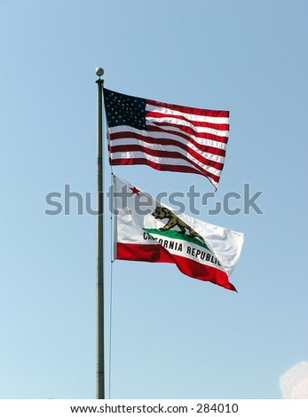 The United States flag on-top of the Californian flag - stock photo