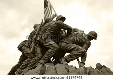 The United States Marine Corps War Memorial depicting the flag raising at Iwo Jima.  Black and white/sepia. - stock photo