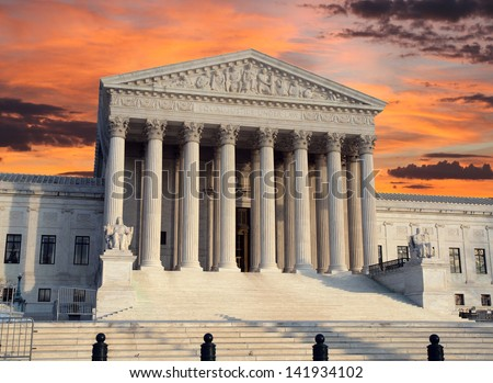 The United States Supreme Court building with sunrise sky.
