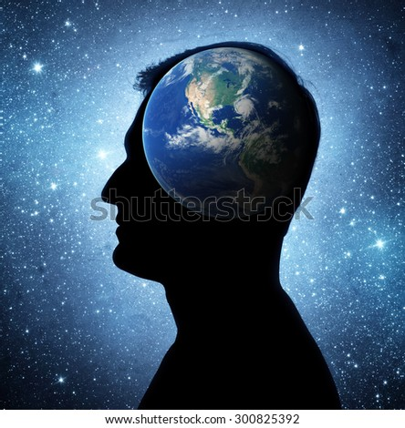 The universe within. Silhouette of a man inside the Earth. The concept on scientific and philosophical topics.  Elements of this image furnished by NASA. - stock photo