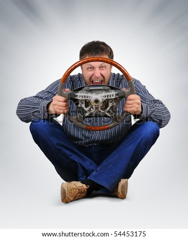 The unreal dude with a wheel in hands - stock photo