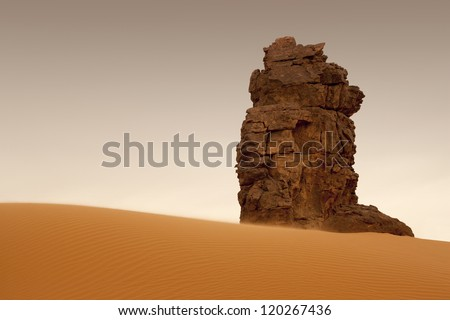 The unusual removed rocks among sand. Libyan Desert. Dense gold dust, dunes and beautiful sandy structures in the light of the low sun. - stock photo