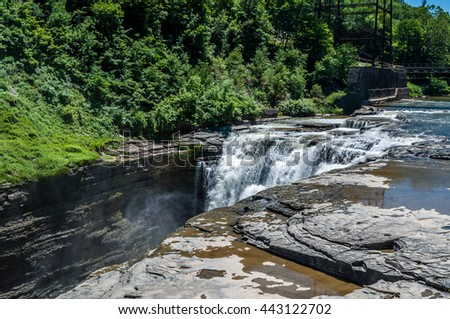 The Upper Falls of the Genesse River drains downward in Letchworth State Park, New York. - stock photo