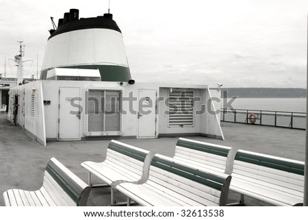 The upper lounge deck of a large ferry boat in black and white. - stock photo