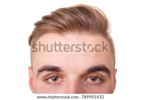 The upper part of the face of a guy. Close-up. Isolated on white.
