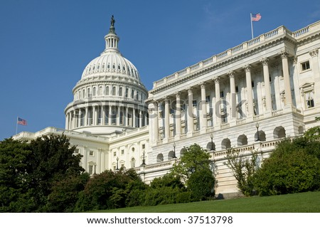 The US Capitol Building where the House of Representatives is in session under the flag flying on the right. - stock photo
